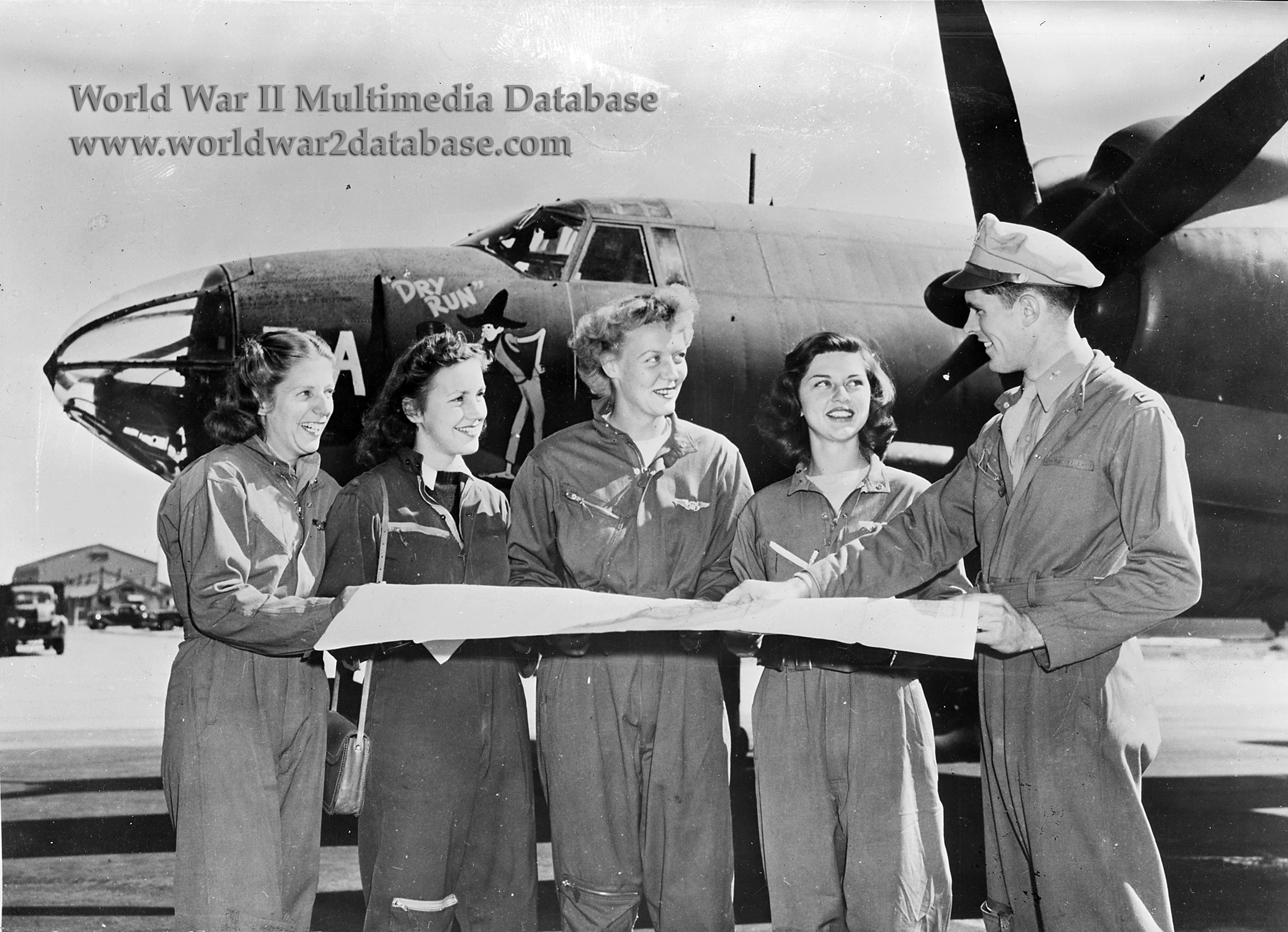WASPs Receive Final Instructions Before Flying Martin B-26 Marauder.  wwii0015.jpg. Caption: Four Women Airforce Service Pilots ...