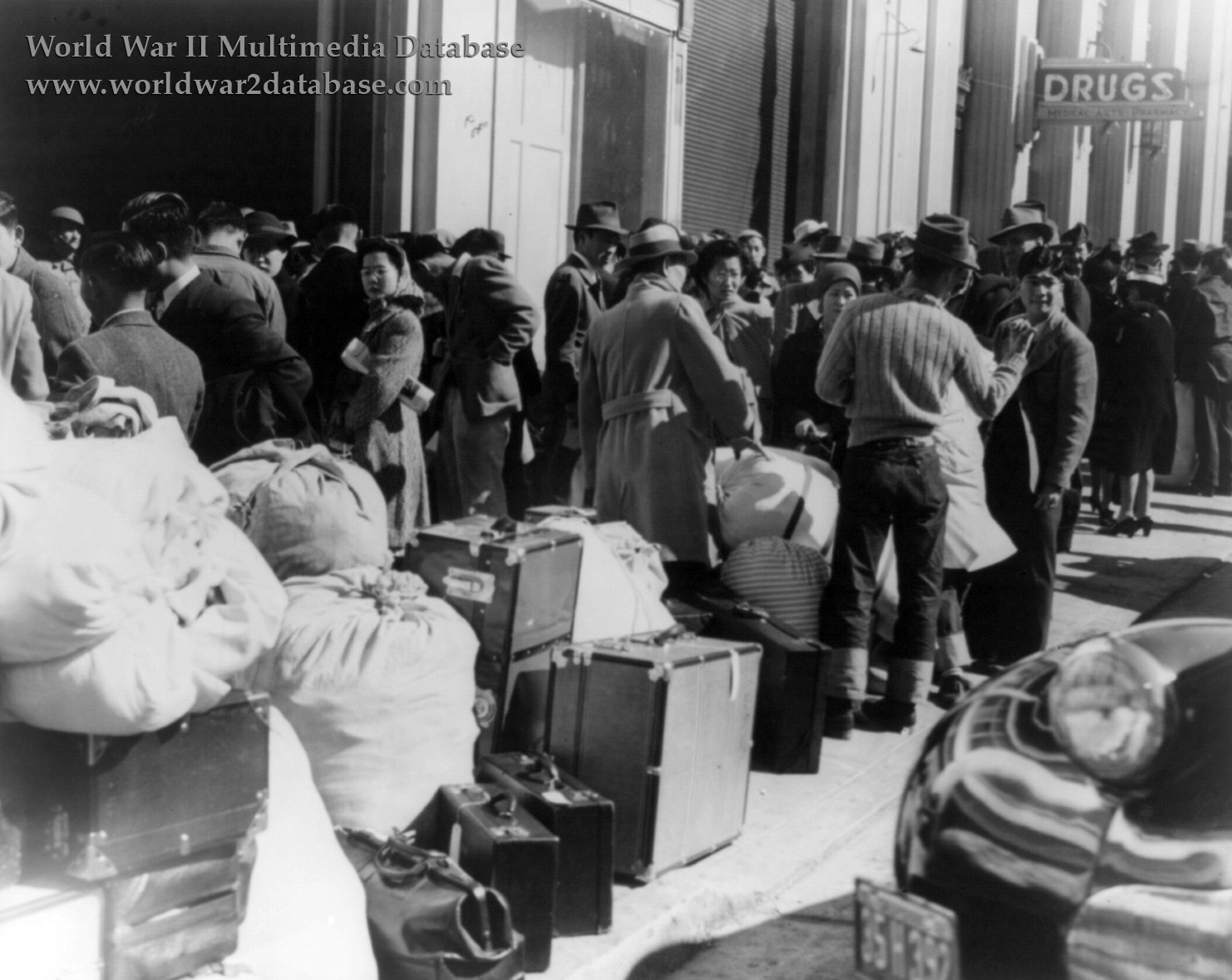 Japanese Americans Queue for Transport to Santa Anita Assembly Center | The World War II ...