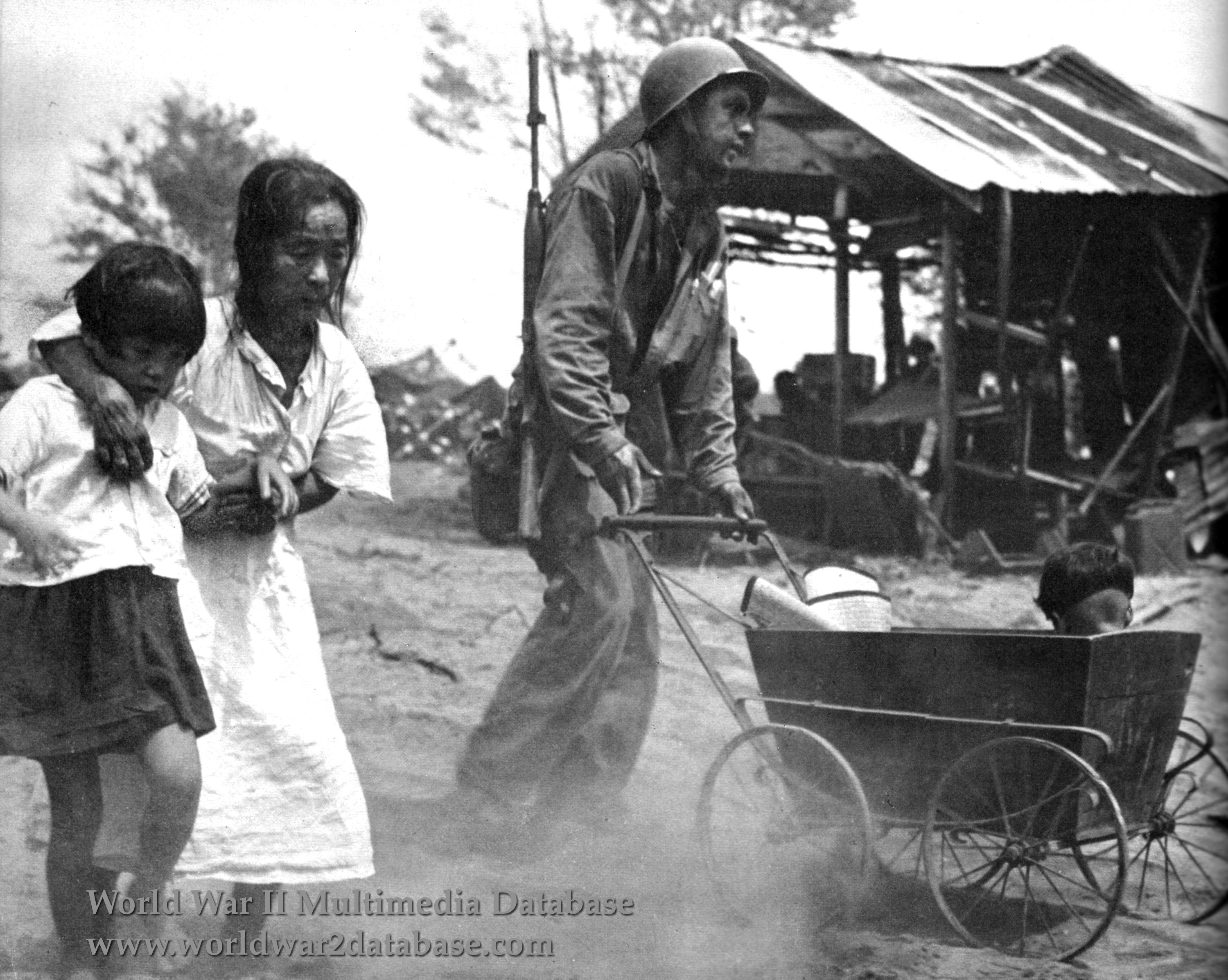 American Assists Japanese Family On Saipan The World War Ii Multimedia Database